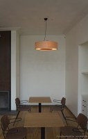 Big round pendant lamp in the shape of a donut, made of maple wood veneer of with several E27 light sockets inside