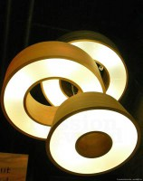 Lighting in the shape of a donut in tulip wood, both decorative and functional light